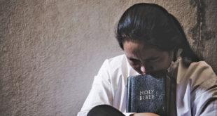 lady praying with Bible