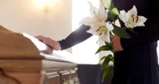 hand on coffin